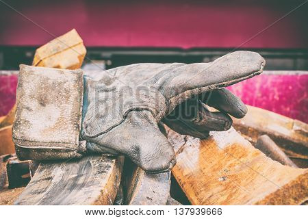 old dirty leather work gloves, The concept of industry.