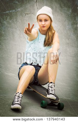 Skater girl showing peace sign