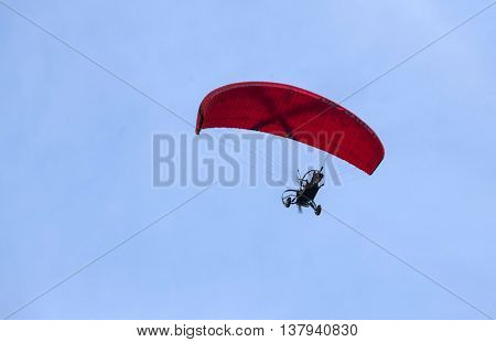 Paraglider againsy blue sky