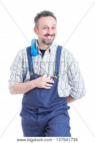 Professional Joyful Mechanic Holding Vintage Telephone On Shoulder