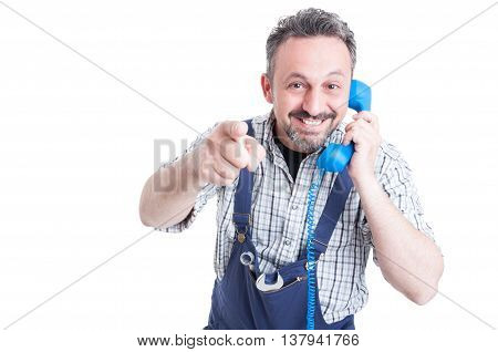 Portrait Of Cheerful Mechanic With Telephone Pointing You