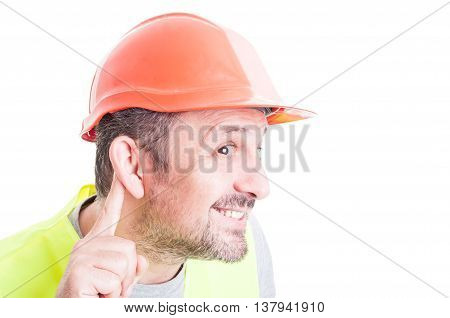 Close-up Of Curious Young Builder Listening Whispers