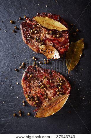 Roasted pork steaks with green peppercorns