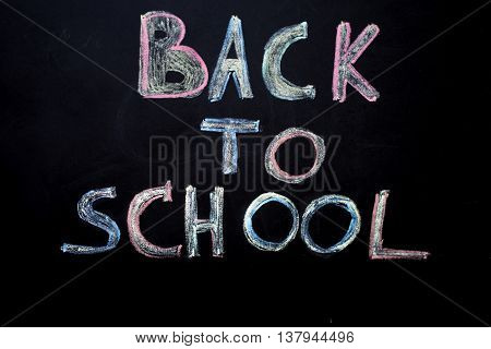 Back to school black background the missile made with pencils drawing crayons books school