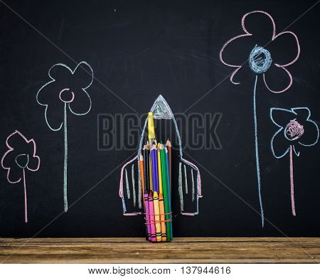 Back to school black background the missile made with pencils drawing crayons school