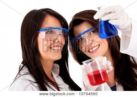 Female chemists using test tubes - isolated over a white background