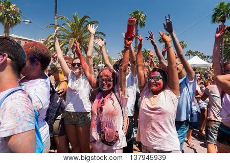 BARCELONA SPAIN - JULY 9 2014: Participators of Holi festival at Escenario del Moll de la Fusta have fun.