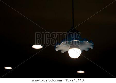 Fluorescent Light Bulb In Hanging Lamp