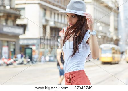 Young beautiful woman with shopping bags in the ctiy- Let's go shopping concept