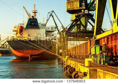 Big ship under unloading coal in Port of Gdansk Poland.