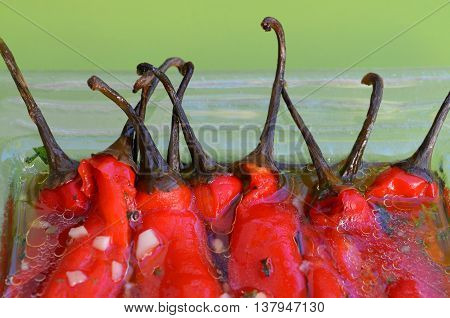 Sour salad of red peppers and garlic in marinade