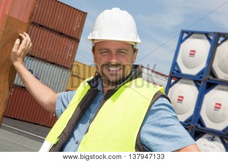 Engineer With Helmet And Truck And Container In Cargo