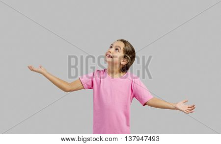 Beautiful little girl with arms open, with copy space