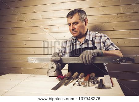 Senior carpenter working in his workshop