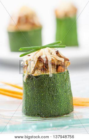 A stuffed zucchini appetizer with mushrooms close up.