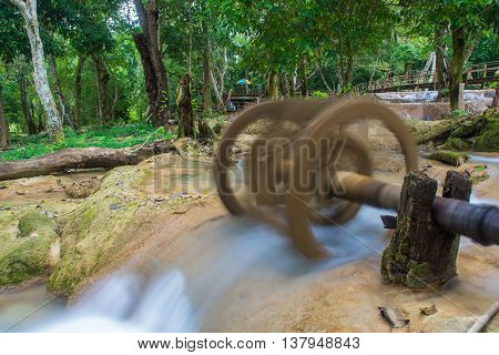 Waterwheel At Tad Sae Waterfalls At Luang Prabang, Laos