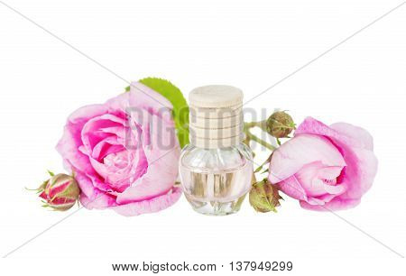 Vial with essential oil and two roses isolated on a white background