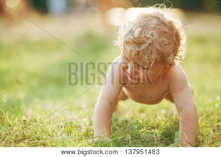 photo of little funny boy on grass