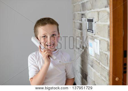 Little Baby Boy Talking On Intercom