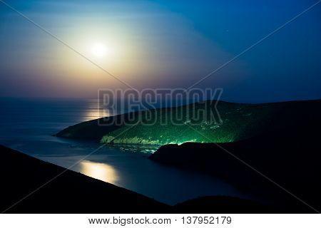 Greek mediterranean sea coast under full moon in Macedonia, Greece