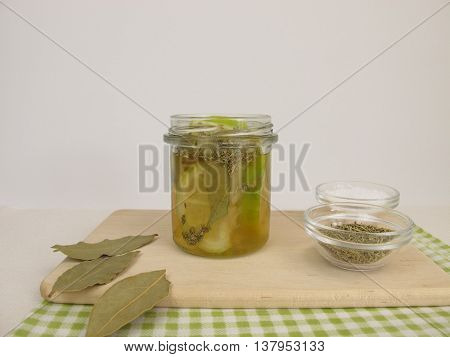 Pickled lemons with rosemary and bay leaves