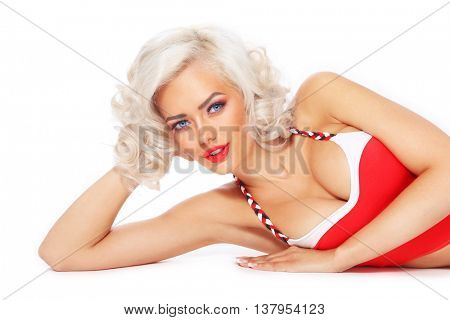 Young beautiful happy smiling sexy tanned blonde woman with curly hair and red lipstick over white background, copy space