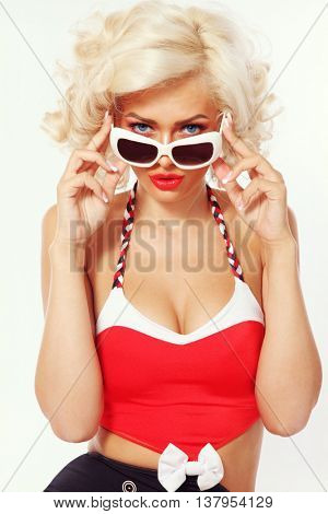 Vintage style portrait of young beautiful sexy blonde woman with vintage sunglasses