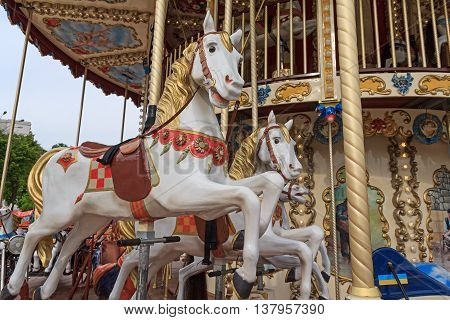 Beautiful horse on the carousel street. Carnival