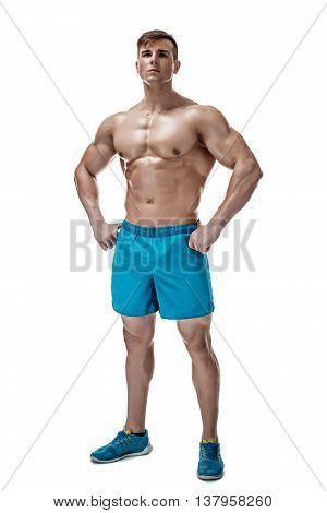 Strong Athletic Man showing muscular body and sixpack abs isolated on white background. full-length