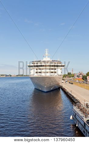 RIGA LATVIA - JUNE 7 2016: 12 decks MS The World (IMO 9219331) in the port of Riga Latvia. The World is the largest privately owned residential yacht (165 apartments gross tonnage 43524 tons)
