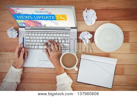 Logo of a search bar in which NEWS UPDATE is written against cropped image of woman with pen using laptop