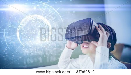 Image of earth with different times against girl wearing virtual reality glasses