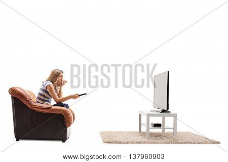 Nervous woman watching a movie on TV and biting her nails isolated on white background