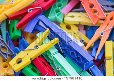 Heap Of Plastic Laundry Clothespin In Vivid Colors