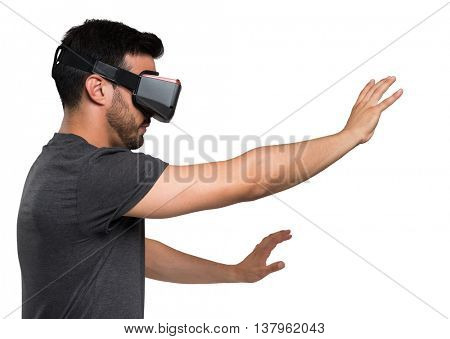 Young man using a VR headset and experiencing virtual reality. Isolated on white background