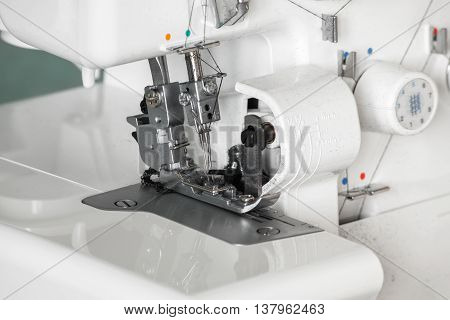 The mechanism of the needle of the sewing machine close-up. Focus on needle