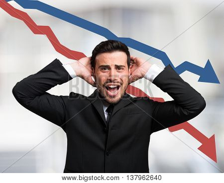 Desperate businessman in front of descending arrows