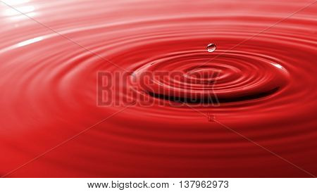 drop of water on a red background