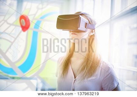 Digitally generated image of map against graphic designer using virtual reality headset in office