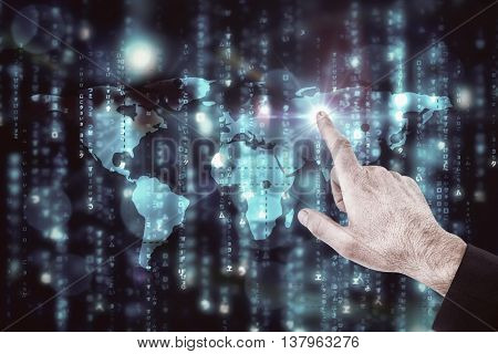 Businessmans hand pointing in suit jacket against digitally generated black and blue matrix