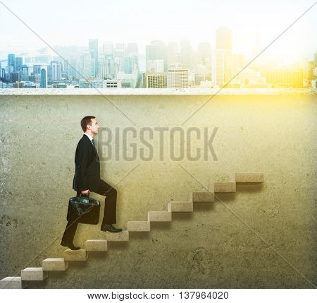 Success concept with businessman climbing concrete ladder on wall