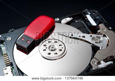 USB Flash Drive on hard disk drive close up