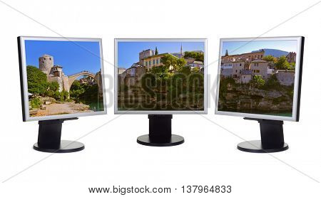 Cityscape of Mostar - Bosnia and Herzegovina (my photo) on computer monitors - isolated on white background