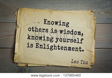 Ancient chinese philosopher Lao Tzu quote on old paper background.  Knowing others is wisdom, knowing yourself is Enlightenment.