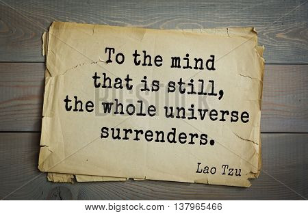 Ancient chinese philosopher Lao Tzu quote on old paper background.  To the mind that is still, the whole universe surrenders.
