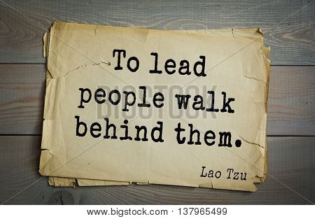Ancient chinese philosopher Lao Tzu quote on old paper background.