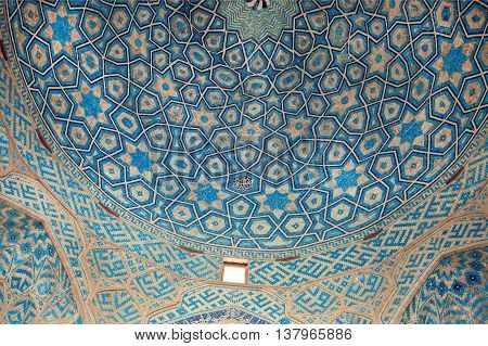 YAZD, IRAN - OCT 19, 2014: Patterns of ceramic tile of the blue ceiling of the historic mosque on October 19, 2014. With population of 270.600 families, Yazd is centre of Persian architecture