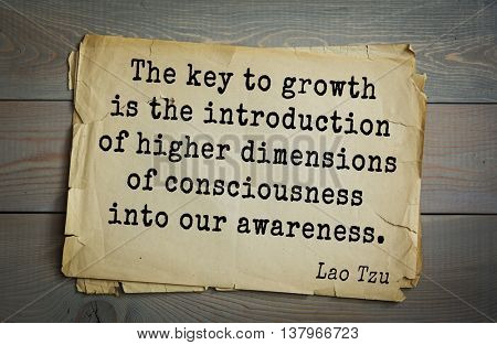 Ancient chinese philosopher Lao Tzu quote on old paper background.  The key to growth is the introduction of higher dimensions of consciousness into our awareness.
