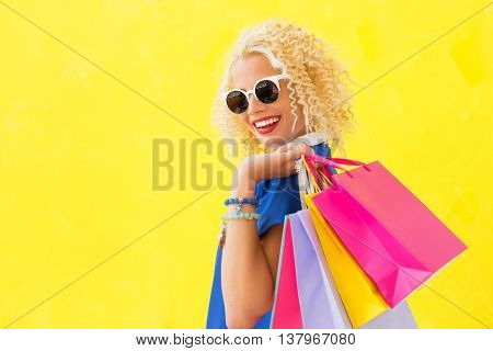stylish woman with sun glasses and shopping bags