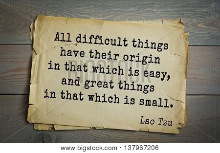 Ancient chinese philosopher Lao Tzu quote on old paper background.  All difficult things have their origin in that which is easy, and great things in that which is small.